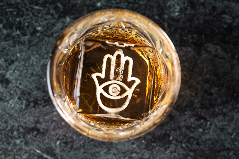 glass with hand inlay